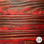 Image of different reds on burnt wood