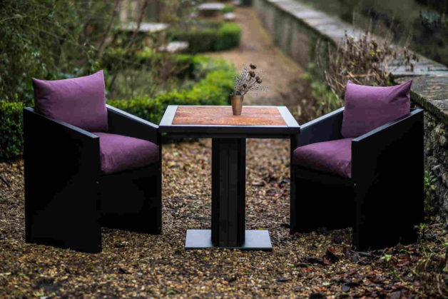 rust bistro table and purple chairs