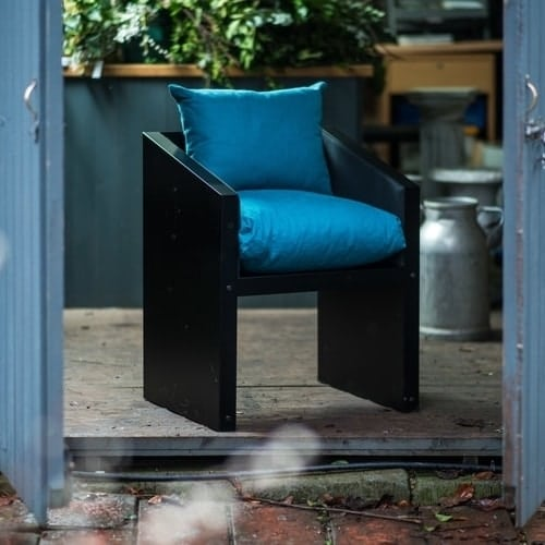 Garden or dining chair with blue cushions