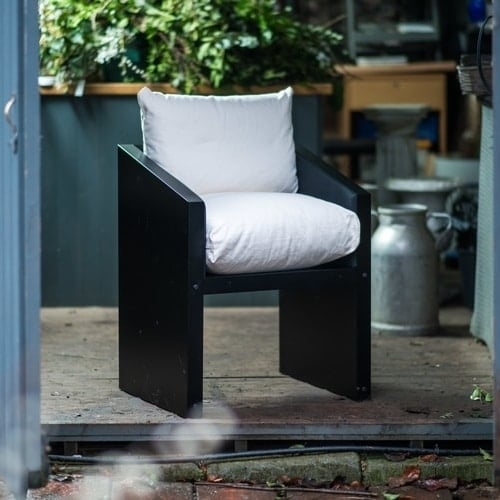 Garden or dining chair with white cushions