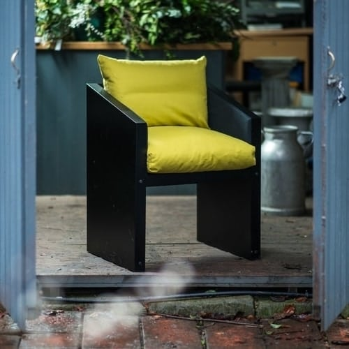 Ironfire dining chair with yellow cushions