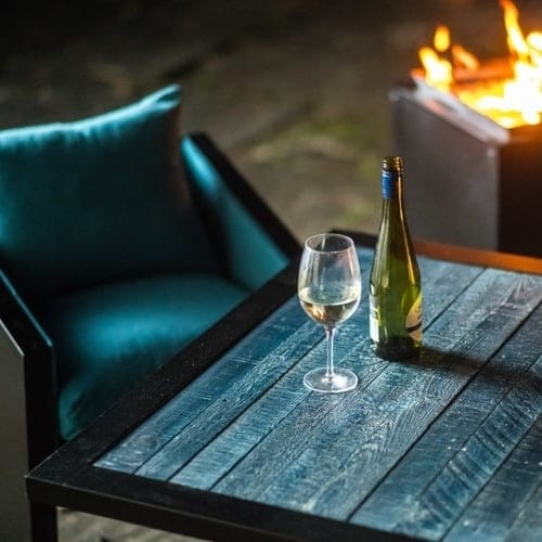 blue bistro chair and fire pit