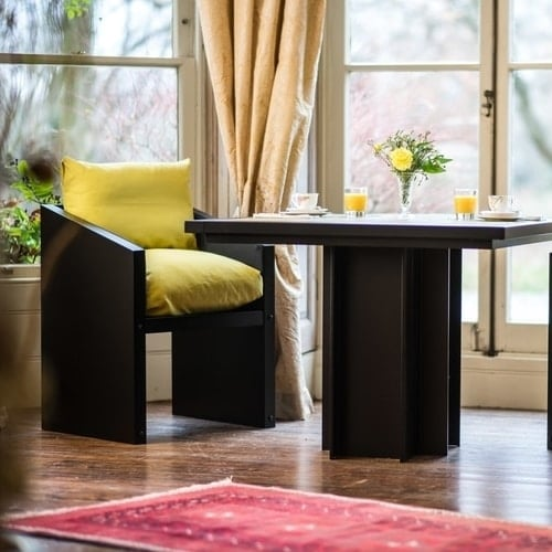 yellow chair and bistro table